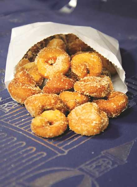 COURTESY PHOTO - Mythical Mini Donuts specializes in cinnamon sugar discs of goodness.