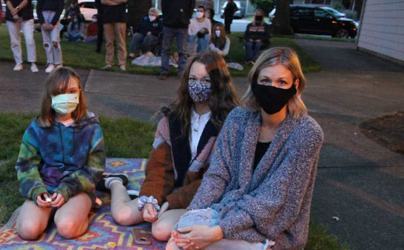 PMG FILE PHOTO: KRISTEN WOHLERS - A Canby family wears masks in public at an anti-racist vigil.