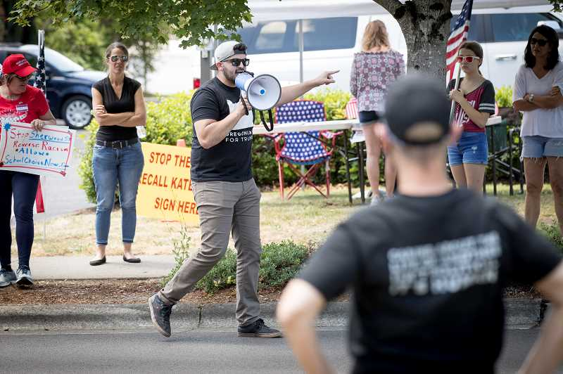 PMG PHOTO: JAIME VALDEZ - David leads a group of Oregonians for Trump All Kids Matter rally in front of the Sherwood School District Friday afternoon.