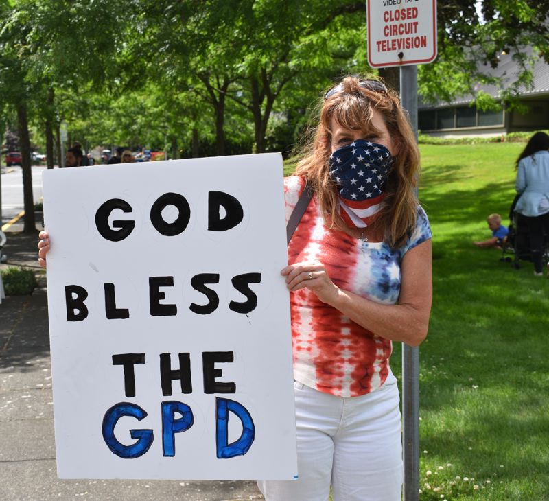 PMG PHOTO: TERESA CARSON - Sally Macklin carried her sign and wore her red, white and blue clothes to champion law enforcement.