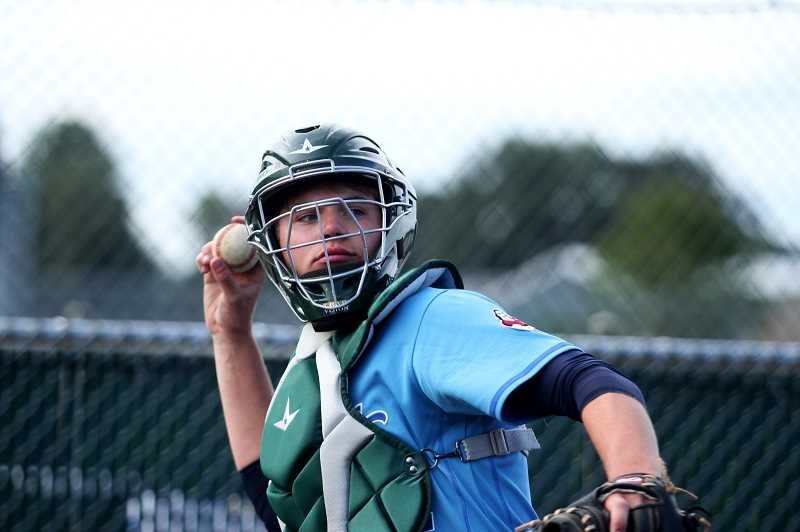 PMG PHOTO: PHIL HAWKINS - Noah Wierstra helped the Gherkin pitchers warm up throughout the game and entered the game in the ninth inning, drawing a walk and reaching third base before the Pickles eventually won 2-1.