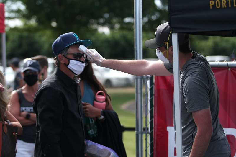 PMG PHOTO: PHIL HAWKINS -  Guests were given temperature checks before entering the grounds at North Marion High School's Bob Brack Stadium and were given complimentary masks if they didn't have them.