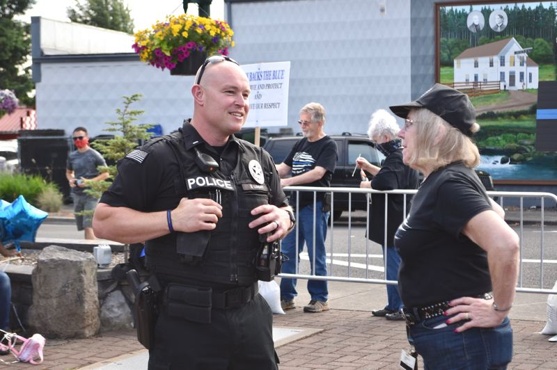 PMG PHOTO: BRITTANY ALLEN - Lt. Sean Lundry of the Sandy Police Department talks with Sandy Backs the Blue co-organizer Juli Hager.