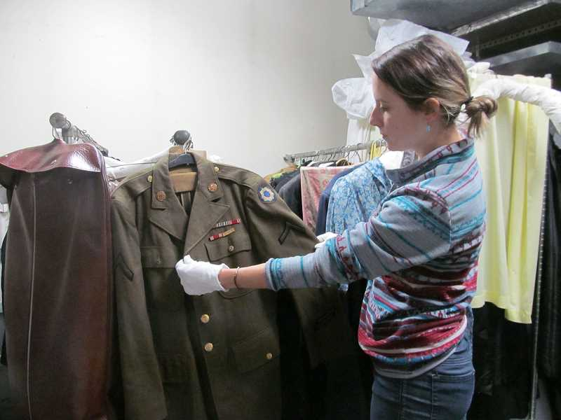 PMG FILE PHOTO: ELLEN SPITALERI - Clackamas County Historical Society Executive Director Jenna Barganski noted that historic military uniforms donated by local residents are among the most requested items to be viewed at the Museum of the Oregon Territory.