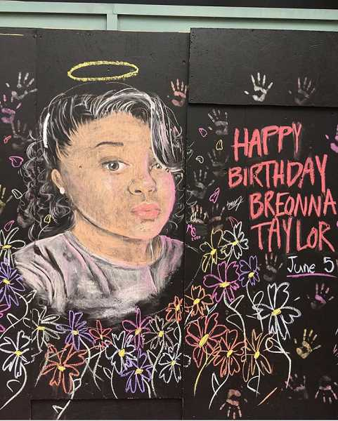 IMAGE COURTESY OF BRADY CRESWELL - A chalk mural of Breonna Taylor, done by Brady and Mia Creswell, graces a boarded up area of the Louis Vuitton store in downtown Portland.