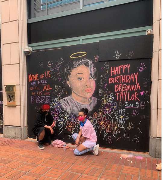 IMAGE COURTESY OF LEIGH ANN CRESWELL - Twins Brady and Mia Creswell pose in front of a chalk mural they created on the Louis Vuitton store in downtown Portland. The mural depicts Breonna Taylor, a Kentucky woman shot and killed by police while sleeping in her home.