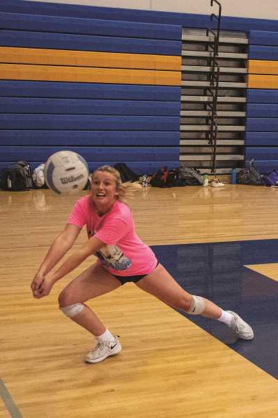 LON AUSTIN - Defensive specialist Kaccie Stafford stretches for a return. The senior is thrilled that the volleyball program is back on the court after coronavirus condtions delayed program activities.