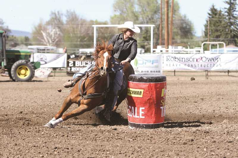 CENTRAL OREGONIAN - Kennedy Buckner, of Powell Butte, spins around a barrel during the state finals in Prineville in June. Buckner is heading to the National High School Rodeo Finals in Guthrie, Oklahoma. Three other Crook County athletes are going as well: Wyatt Wood, Deaglan Lundquist and Jace England.
