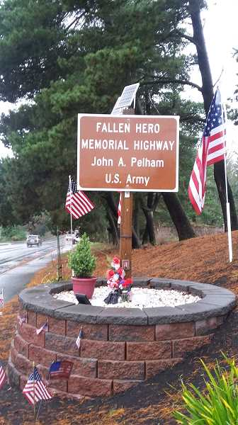 COURTESY PHOTO - For Adam Jones Eagle Scout Project, he beautified a busy Beaverton street corner off Highway 217 and Walker Road that had a Fallen Hero Memorial honoring U.S. Army solider John Pelham who died in Afghanistan.