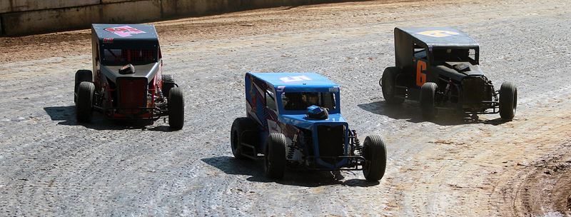PMG PHOTO: MILES VANCE - Jake VanOrtwick (left to right), Teagan Fischer and Christopher Kross slide through a corner in the Dwarf Car main during the Columbia County Racing Association's 2020 season opener at the River City Speedway on Sunday, July 12.