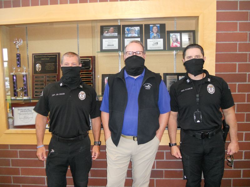 PMG PHOTO: SCOTT KEITH - From left, Capt. Jon Carlson, Chief Jeff Groth and Capt. Ty Hanlon of the Sherwood Police Department.