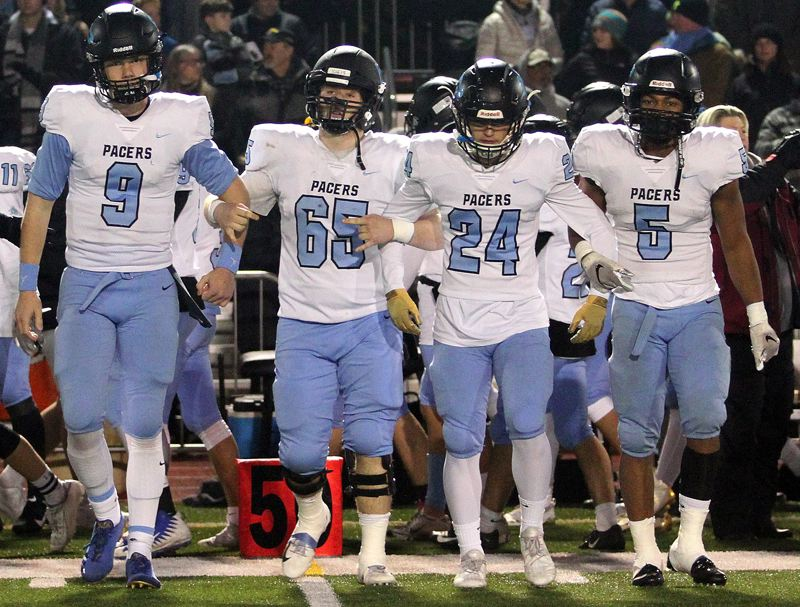 PMG PHOTO: MILES VANCE - Lakeridge senior captains (from left) Cooper Justice, Kai Tinker, Caiden Biege-Wetherbee and Jalen John were all honored on Three Rivers League all-star teams for 2019., Lake Oswego Review - Sports LO seniors Filkins and Shanks named POY for 2019 season Lake Oswego, Lakeridge football see 41 honored on all-Three Rivers League teams