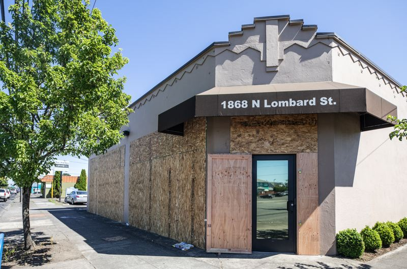 PMG PHOTO: ZANE SPARLING - The Portland Police Association building was boarded up by contractors after another protest was held nearby on Monday, July 13.