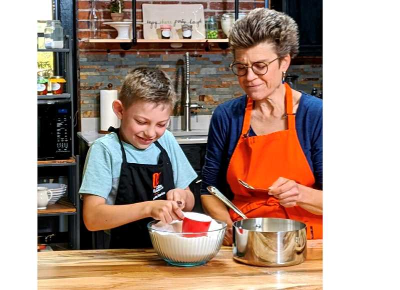 COURTESY PHOTO - Kelly Streit and Jamison Axmaker demonstrate how to make freezer jam in a video produced at Willamette Falls Studio in Oregon City.