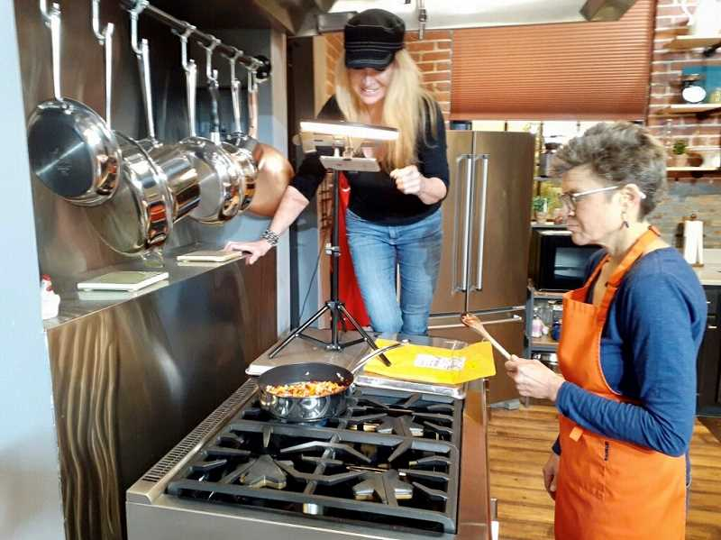 COURTESY PHOTO - Kimberly Jacobsen grabs an over-the-stove shot of Kelly Streit cooking lentil taco filling at the Willamette Falls Studio kitchen in Oregon City.