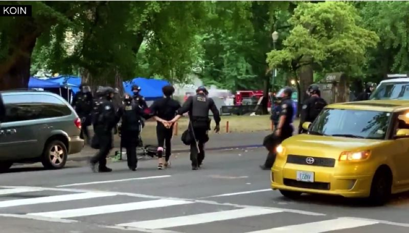 KOIN 6 NEWS - Police arresting protester Thursday morning as they close two parks.