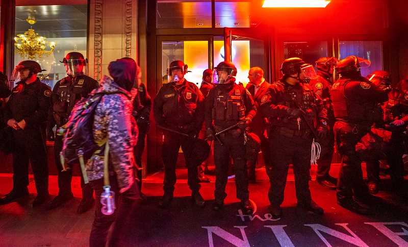 PMG PHOTO: JONATHAN HOUSE - Portland Police Bureau officers stand guard during a downtown demonstration in 2017.