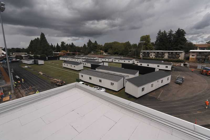 COURTESY PHOTO: NCSD - Portable buildings at Milwaukie High School are removed from the football field in preparation for the building's fall reopening.