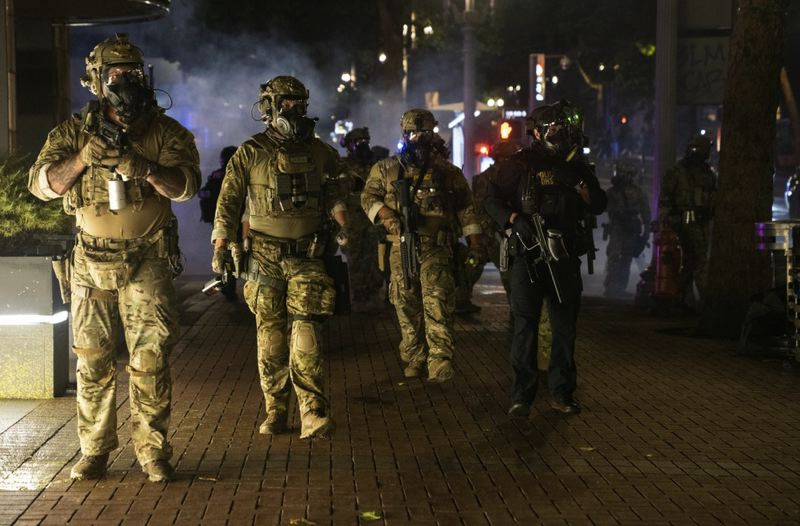 OPB PHOTO - Federal police patrol Portland during a recent protest.