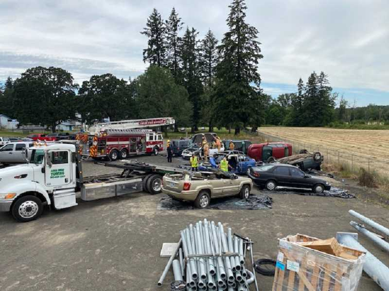 COURTESY PHOTO: ADAM CARTER - Canby Fire crews practice extricating people from wrecked vehicles.