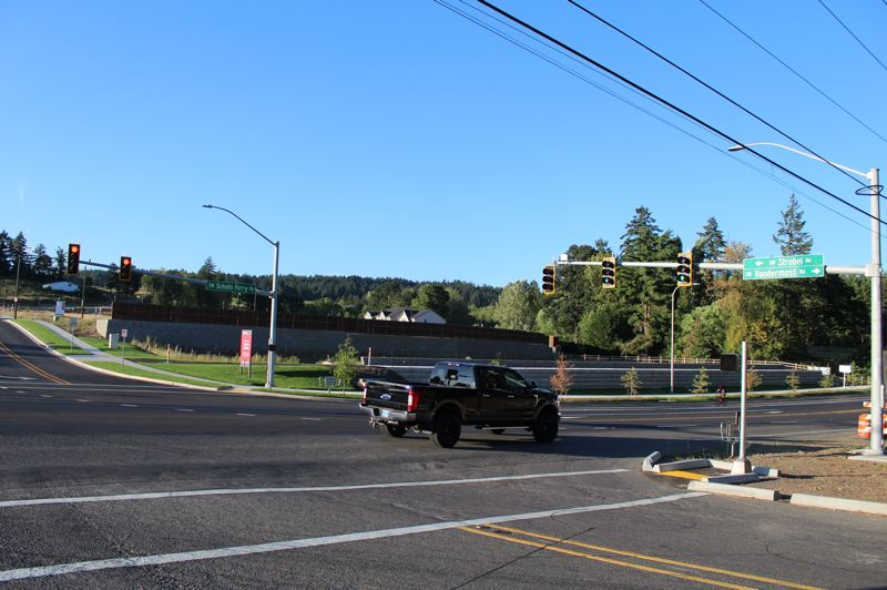 PMG PHOTO: MARK MILLER - A pickup truck passes through the newly signalized intersection at Southwest Strobel and Vandermost roads along Highway 210, signed locally as Southwest Scholls Ferry Road, in Beaverton.