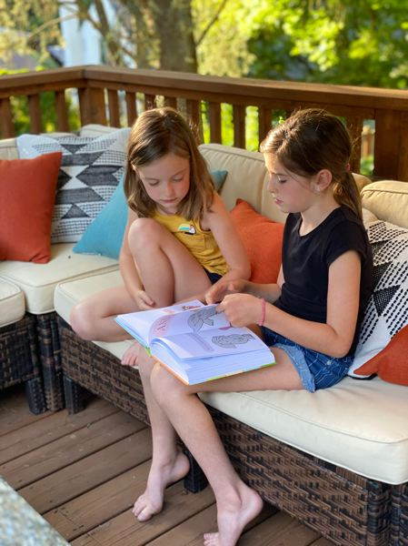 COURTESY PHOTO - Debi Panning's daughters during reading time last spring.