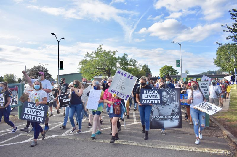 PMG PHOTO: EMILY LINDSTRAND - Participants in Estacada's march against racism begin their journey from Estacada High School to City Hall.