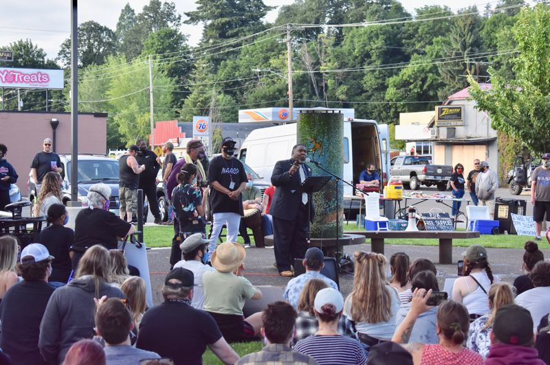 PMG PHOTO: EMILY LINDSTRAND - Portland NAACP President E.D. Mondaine addresses attendees of a march against racism in Estacada.