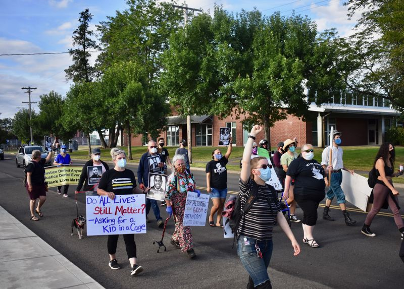 PMG PHOTO: EMILY LINDSTRAND - Participants in a march against racism walked from Estacada High School to City Hall.