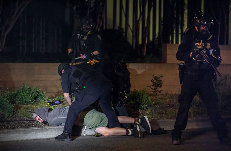PMG PHOTO: JONATHAN HOUSE - Department of Homeland Security officers arrest a Portland protester during a demonstration on Friday, July 17, near the Edith Green-Wendell Wyatt Federal Building in downtown Portland