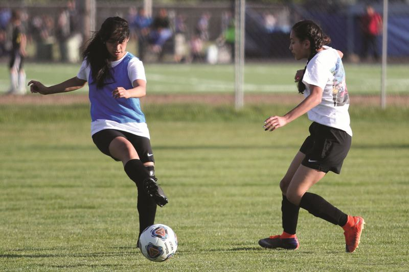 PMG FILE PHOTO: PHIL HAWKINS - At this time last year, the Woodburn girls soccer team was meeting regularly for scrimmages, helping to pave the way for the team's first state championship four months later.