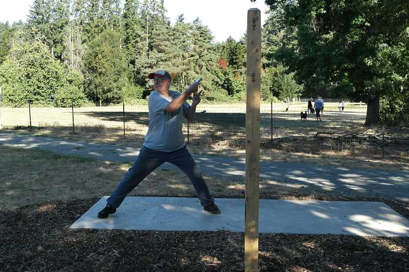 SPOKESMAN PHOTO: CLAIRE COLBY - Disc golf has grown in popularity over the past several decades, primarily due to it being an inexpensive, family-friendly activity.