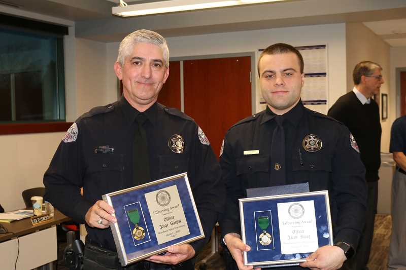 PMG FILE PHOTO - The Woodburn SRO program, which consisted of officers Jorge Gaspar, left, and Jacob Stout, was placed on hiatus in June. The Woodburn School District is soliciting feedback from the community on wheather or not to bring it back in the fall.