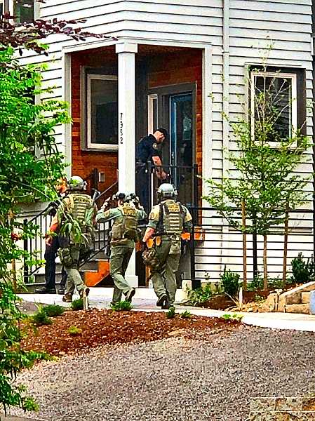 COURTESY OF SUZANNE OGORMAN  - Officers prepared to make entry into the new - unsold - condominium unit where a man, seen with a pistol, was hiding.