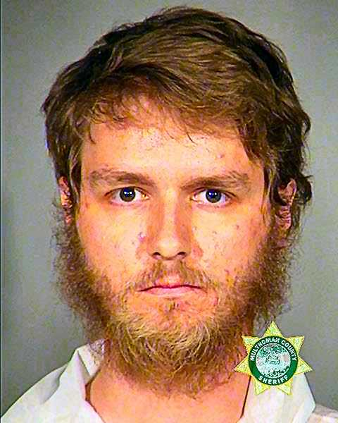 MCDC BOOKING POTO - Although this intruder, 25-year-old Gray Tristan Stockton, caused the SERT turnout and menaced officers with a fake pistol, and faced two charges, he walked free from jail the morning after the incident.   Condo shooting_006.jpg  Courtesy Portland Police Bureau Officers found this realistic-looking Airsoft pistol in the closet of the vacant condo where the intruder had been hiding.   Condo shooting_007.jpg  David F. Ashton SERT officers headed up S.E. 6th Avenue, toward the newly-built, and still-vacant, condo complex.