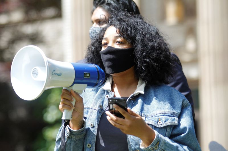 PMG PHOTO: WADE EVANSON - Imani Dorsey addresses a crowd during a protest Wednesday, June 17, at the Washington County Courthouse in Hillsboro.