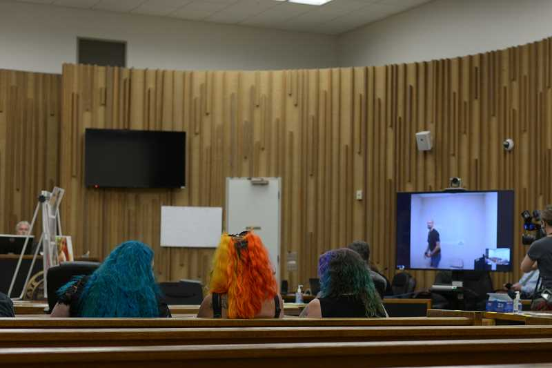 PMG PHOTO: ANNA DEL SAVIO - Family members of Apache Hightower attend sentencing on July 16. Jesse Lane, on the screen, appeared remotely from Two Rivers Correctional Institute, where he is serving a life sentence.