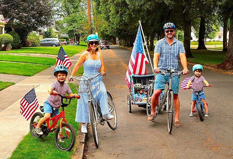 DAVID F. ASHTON - Participating in this years July 4th Eastmoreland Promenade on decorated bicycles were the members of the Agee family.