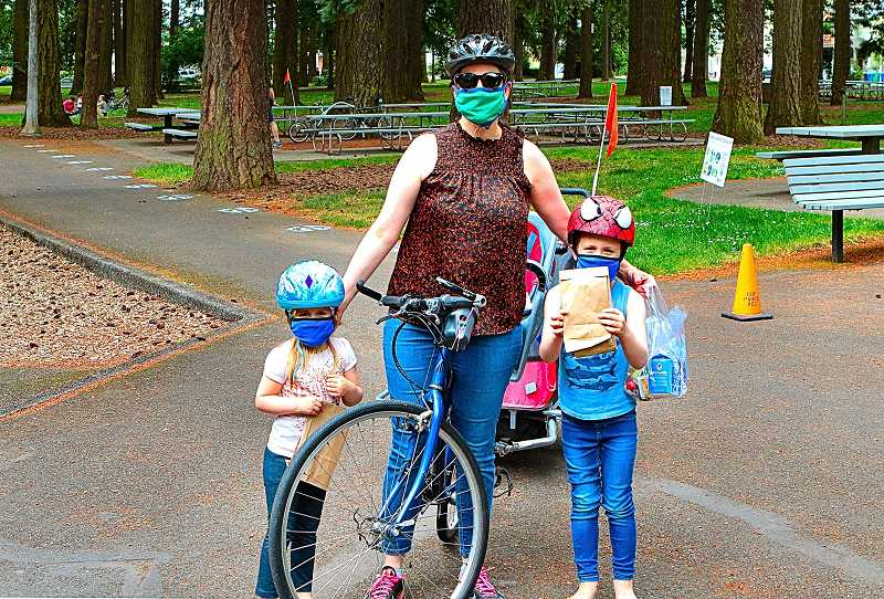 DAVID F. ASHTON - Woodstock resident Kimberly Barbara, flanked by her kids Elizabeth and Theodore, told THE BEE shes thankful for the Portland Parks Free Lunch + Play program.