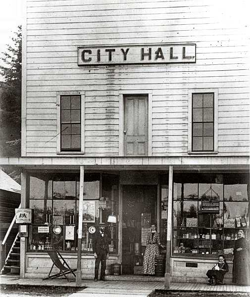 COURTESY OF SMILE HISTORY COMMITTEE - Grocery by day, City Hall by night! John W. Campbell graciously offered the upstairs of his grocery store for Sellwood City Hall meetings in the evening. Hopefully, residents engaged in heated arguments about city polices didnt leave in a rush and mistakenly head out of the top floor door instead of using the side door to the stairway exit.