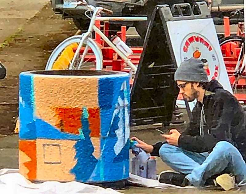 COURTESY OF VICKIE WALSH, FAT ALBERT'S - Heres the undisclosed, but obviously talented, artist at work on a trash can across from Fat Albert's Restaurant on S.E. Milwaukie Avenue.
