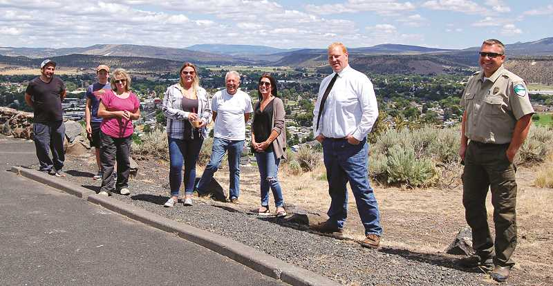 RAMONA MCCALLISTER - A local group of community members gathered on Tuesday, July 7 to set up a maintenance plan for the Ochoco View Point State Park area. From left: Matt Levi, Dylan Levi, Renee Moss, Amanda Luelling, Stanley Flynn, Kim Daniels, Seth Crawford and Mike Simonsen.