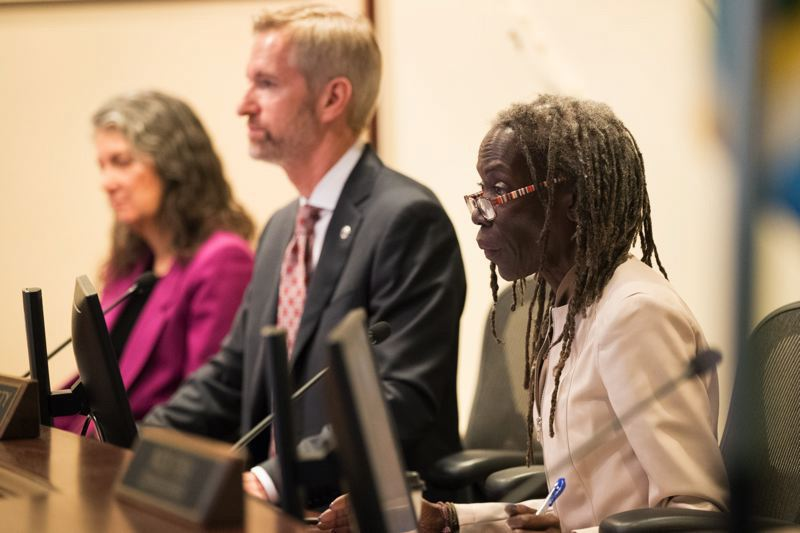 PMG FILE PHOTO - Mayor Ted wheeler and Commissioner Jo Ann Hardesty, right, at a 2019 City Council meeting. They have feuded over leadership of the Portland Police Bureau.