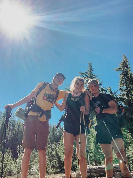 SUBMITTED PHOTO - From left, Caden Bulic, Marah Binder and Shiloh Binder break for a photo during their July hike on the Pacific Crest Trail.