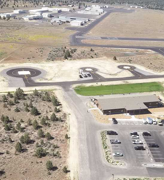 PHOTO SUBMITTED BY CHAD SCHMIDT  - An aerial shot of the new heli-base at Prineville Airport, which features a 9,999 square-foot buiding and three heli-pads for wildfire suppression.