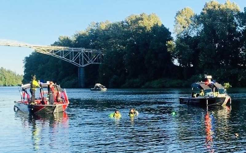 COURTESY PHOTO - Personnel from the Tualatin Valley Fire & Rescue water rescue team search the Willamette River on Monday evening for a Newberg youth.