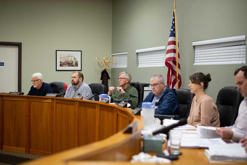 PMG PHOTO: ANNA DEL SAVIO - Scappoose City Council members listen to speakers at a council meeting.