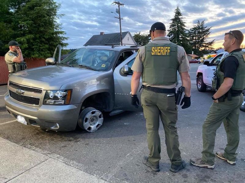 COURTESY PHOTO - Clackamas County Sheriff's Office deputies recently arrested the driver of an SUV with a tire missing a wheel on a charge of DUII.