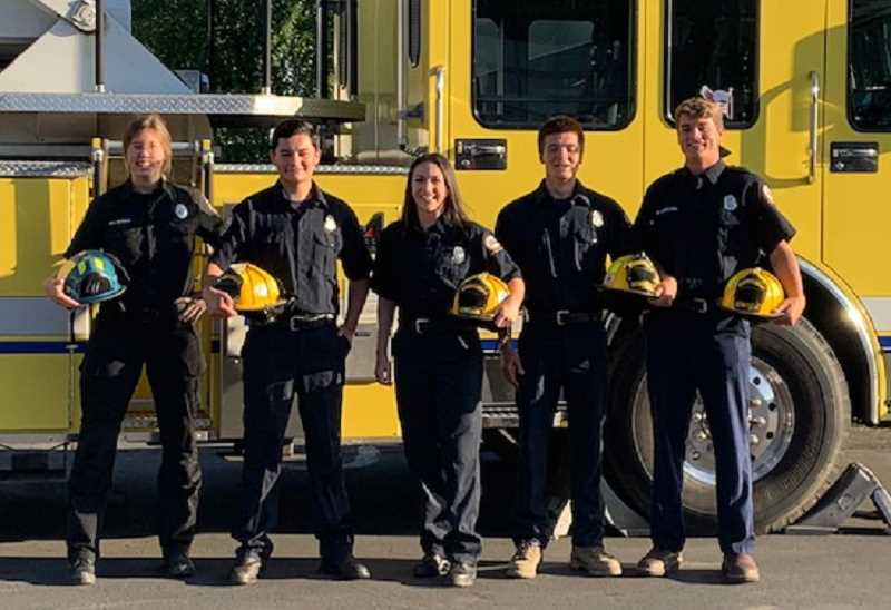 COURTESY  PHOTO: WOODBURN FIRE DISTRICT - Regional volunteer firefighter training academy graduates, from left, Stacy Newman with Aurora Fire and Woodburn Fire District members Marcos Mendoza, Jessi Cornforth, Daniel Vargas, Noah Wiestra. Not pictured but also graduates from Aurora Fire are Daniel Marting, and Alex Cheney.