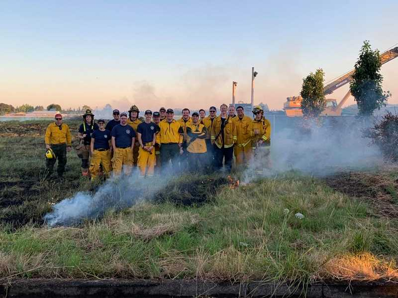 COURTESY PHOTO: WOODBURN FIRE DISTRICT - Firefighters from Hubbard and Woodburn take part in a wildfire drill July 13 in Hubbard.